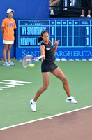 Anne Keothavong hitting a return at a World Team Tennis match in Newport Beach, CA in July 2011.